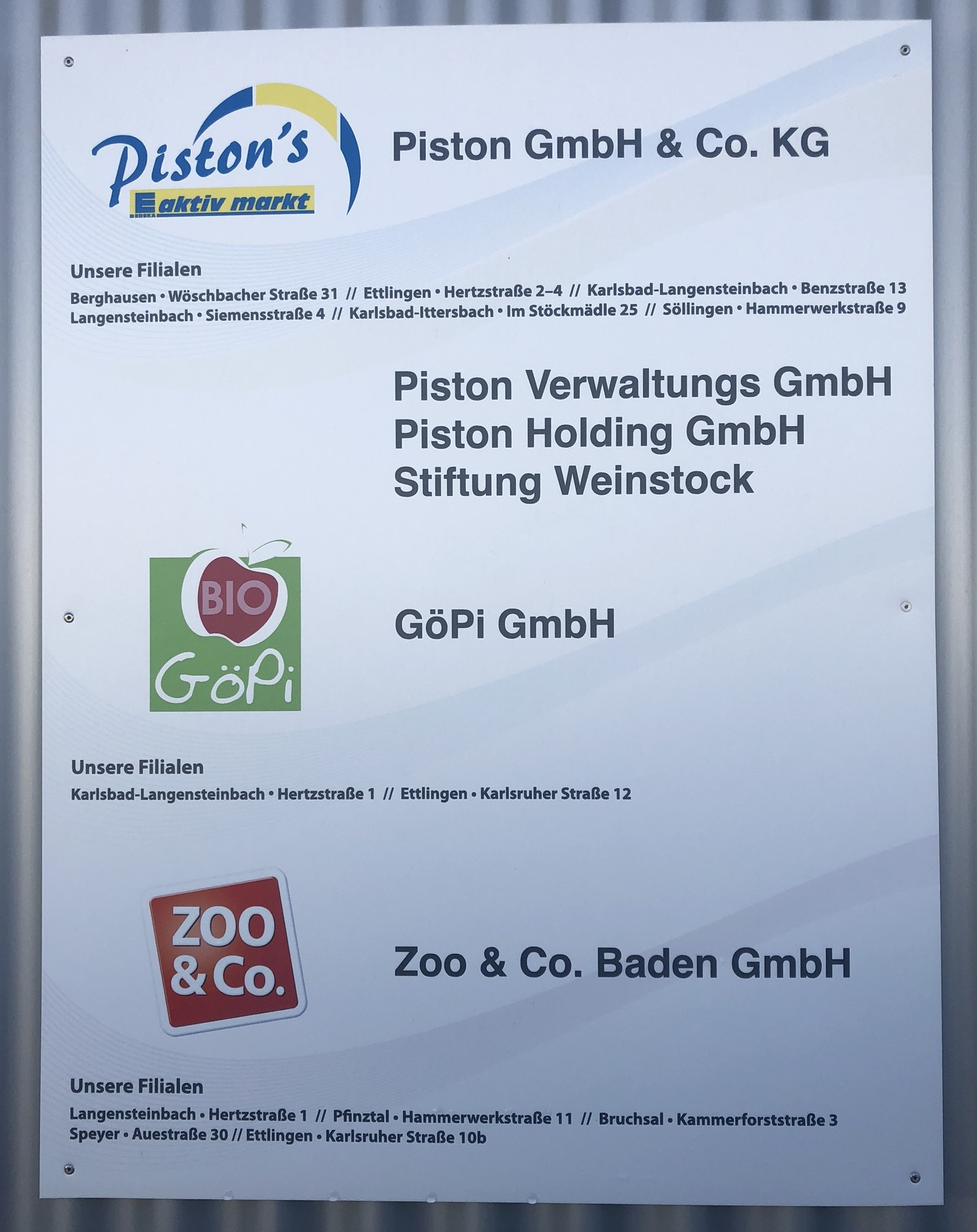 Piston - Firmenschild in Karlsbad - Ittersbach